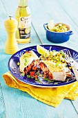 Salmon enchilada with an avocado and sweetcorn salad (Mexico)