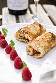 Pancakes filled with raspberries and ice cream