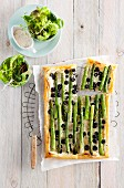 Asparagus and olive cake with green salad