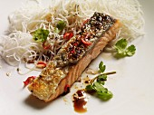 Grilled salmon fillet with black pepper, chilli, coriander and noodles