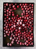 Frozen cranberries on a baking tray