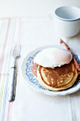 American pancakes with a poached egg