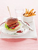 Spicy lentil burger with ketchup and chips