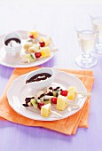 Fresh fruit skewers with chocolate sauce