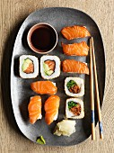 Various types of sushi made with fresh salmon and smoked salmon