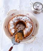 Bundt cake with raisins and icing sugar