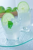 Gin with apple, lime and ice cubes