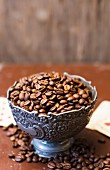 Coffee beans in metal bowl