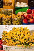 Courgette flowers, grapes and nectarines at a market