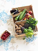 Fresh vegetables, herbs and fruit in a wooden crate