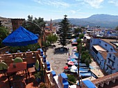 A view from a roof terrace overlooking Uta el-Hammam Square in Chefchaouen, Morocco