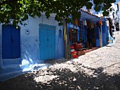A shop set up in one of the blue alleyways of Chefchaouen, Morocco