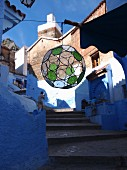 A round lantern in an alley in the Medina of Chefchaouen, Morocco