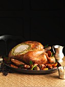 Carved roast turkey with a herb and pistachio filling and side dishes