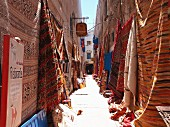 Rugs being sold in the alleys of Essaouira, , Morocco