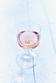 A glass of rosé wine