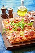 Tomato with prosciutto and rocket pizza