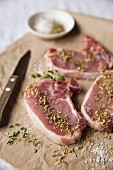 Raw pork chops with various seasonings