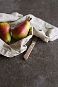 Two pears on a linen napkin
