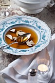 Beef consomme with porcini mushrooms