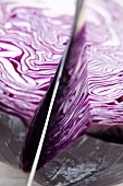 Sliced red cabbage with a knife