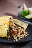 Pad Thai (noodle dish from Thailand) in an omelette