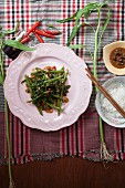 Fried water spinach with bean paste and rice (Thailand)