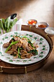 Fried rice noodles with soy sauce and pork (Thailand)