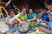Women making desserts, Thailand