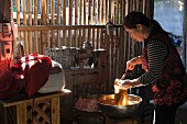 A woman making Thai sausages