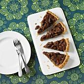 Four slices of pecan nut pie