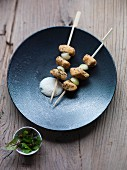 Hake skewers with a sesame seed crust