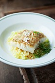 Cod with a roast onion crust on a bed of potato risotto