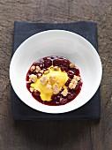 Saffron ice cream with cherry sauce