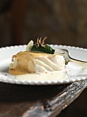 Poached halibut with almond sauce