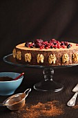Chocolate mousse cake with walnuts and berries