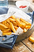 Chips in newspaper on a tray