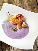 Red cabbage foam soup with pears and prawns