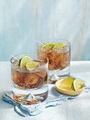 Vodka-Cola with limes and ice cubes