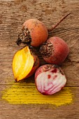 Beetroot and yellow beets on a wooden surface