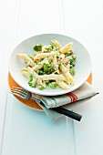 Penne alla carbonara with broccoli and peas