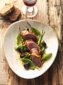 Saddle of wild hare wrapped in ham with mulberries