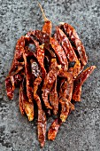 Dried chilli peppers on a stone surface