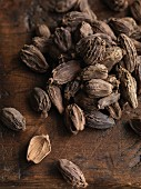Black cardamom on a wooden surface