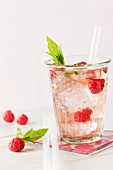 Raspberry lemonade with ice cubes and mint