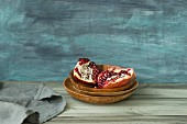 Pieces of pomegranate in a wooden dish