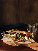 A toasted baguette sandwich with chanterelle mushrooms and Brie