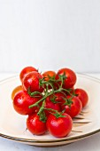 Vine tomatoes on a white plate