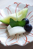 Sashimi with melon, grapes and a gingko leaf (Japan)