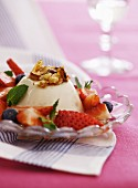 Panna cotta with caramelised nuts and fresh berries